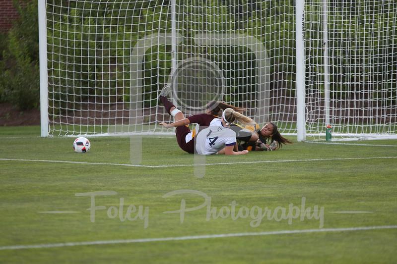 Iona Gaels goalkeeper Tiffany Martinez (1) Holy Cross Crusaders defender Allie Neumann (14)