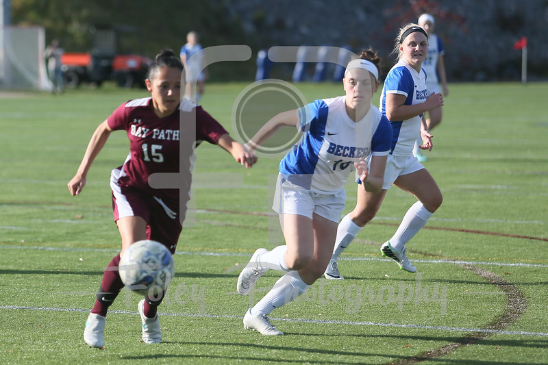 Bay Path Wildcats Megan Mackie (15) Becker College Hawks midfielder Cassandra Nelson (16)