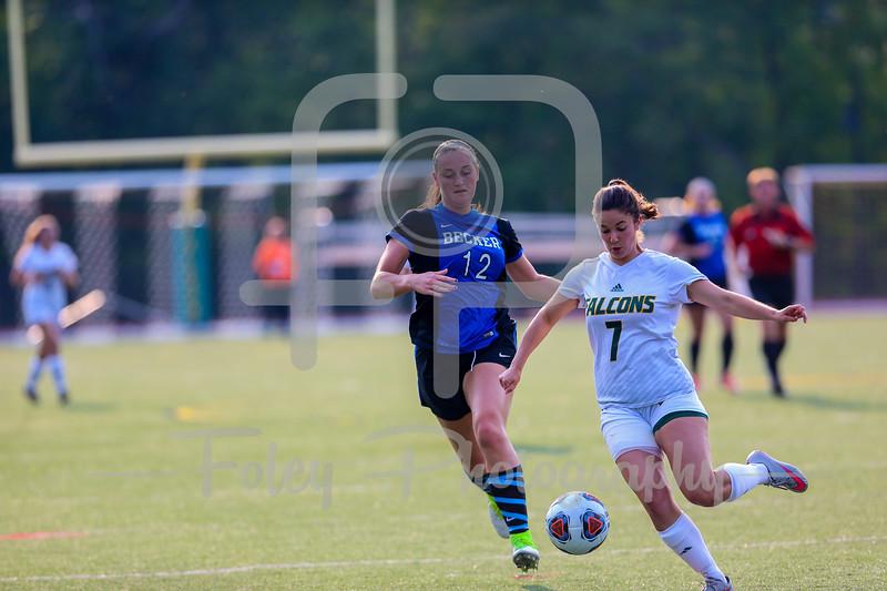 Becker College Hawks midfielder Ciara McKissick (12) Fitchburg State Falcons defender/midfielder Micalea Goldenberg (7)