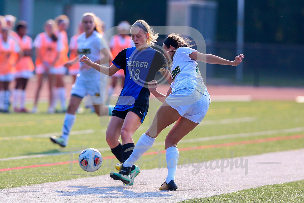 Becker College Hawks midfielder/forward Marissa Felter (18) Fitchburg State Falcons midfielder/defender Hannah Keohan (13)