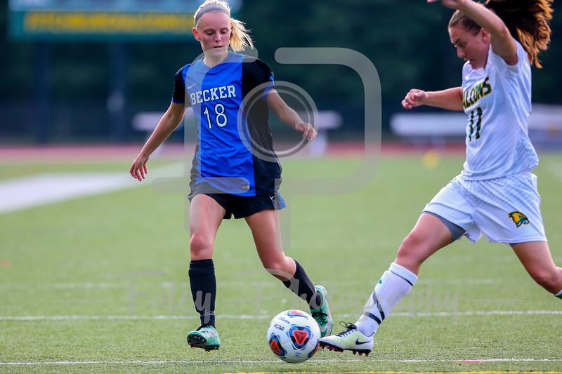 Becker College Hawks midfielder/forward Marissa Felter (18) Fitchburg State Falcons midfielder Maddie Medina (11)