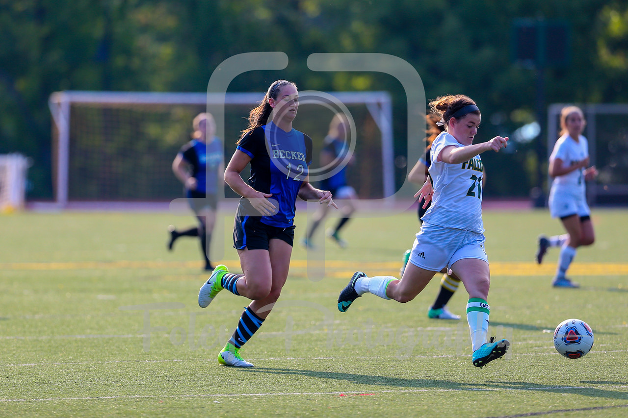 Becker College Hawks midfielder Ciara McKissick (12) Fitchburg State Falcons defender Siobhan O'Connell (21)
