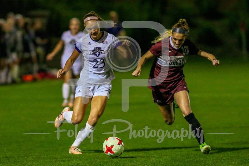 Holy Cross Crusaders Stephanie Lund (23) Colgate Raiders Dom DeMarco (10)