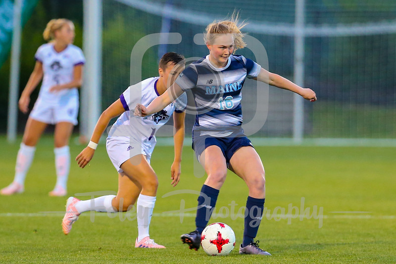 Maine midfielder Nicole Bailey (16)