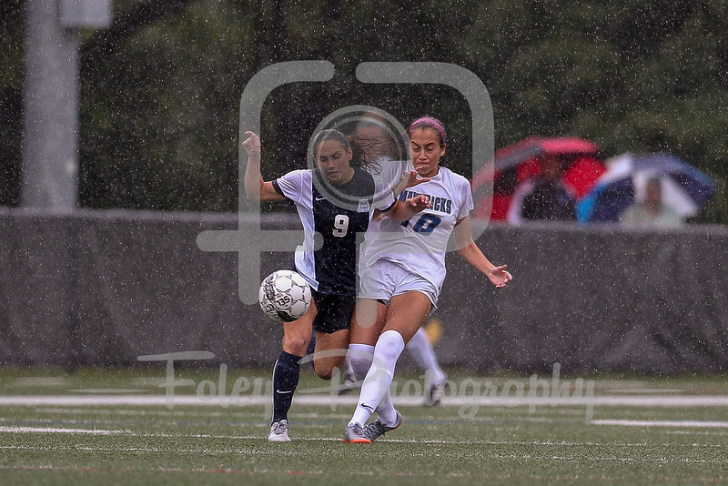 Mercy College midfielder Heidi Serna (10) Southern Connecticut State forward Rossella Graniero (9)