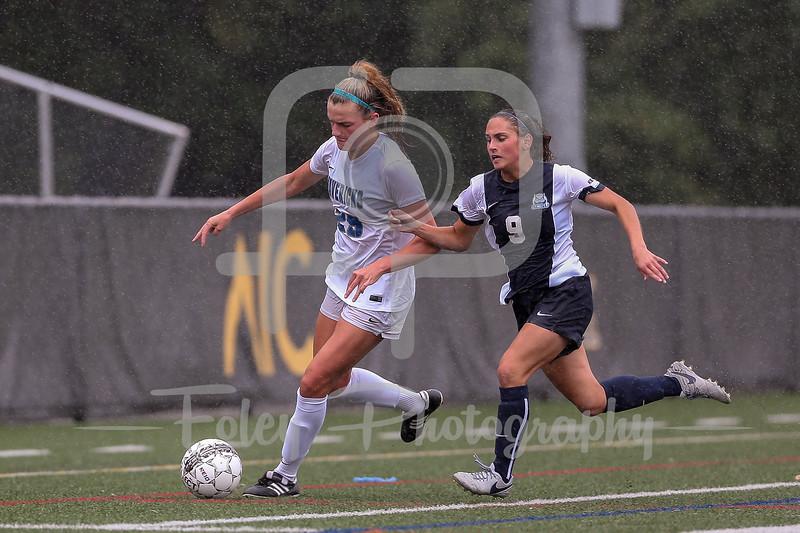 Mercy College Trista Seara (25) Southern Connecticut State forward Rossella Graniero (9)