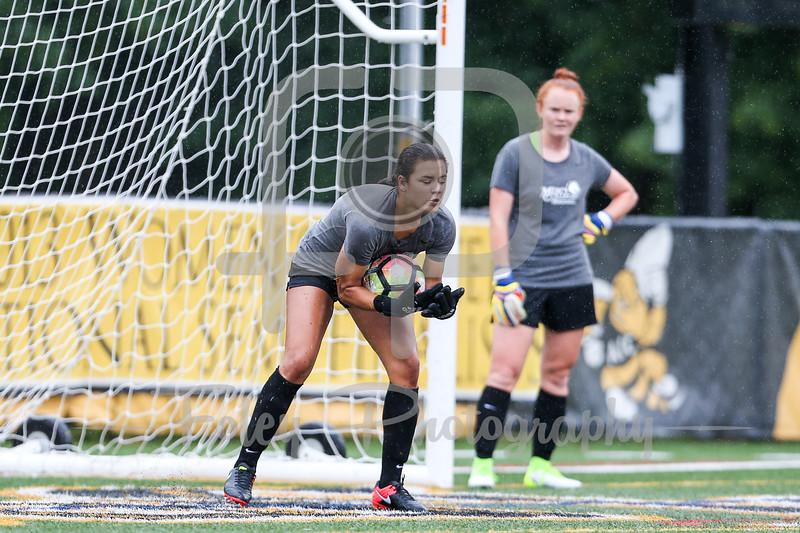Mercy College goalkeeper Melissa Torres (00)