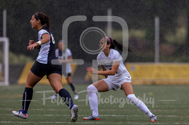 Mercy College midfielder Heidi Serna (10)