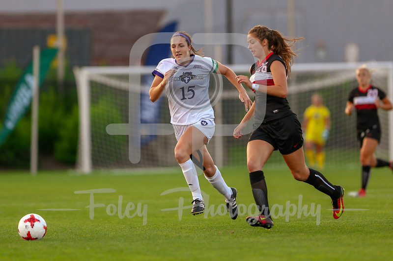Holy Cross Emily George (15) Northeastern Shannon Simmons (26)
