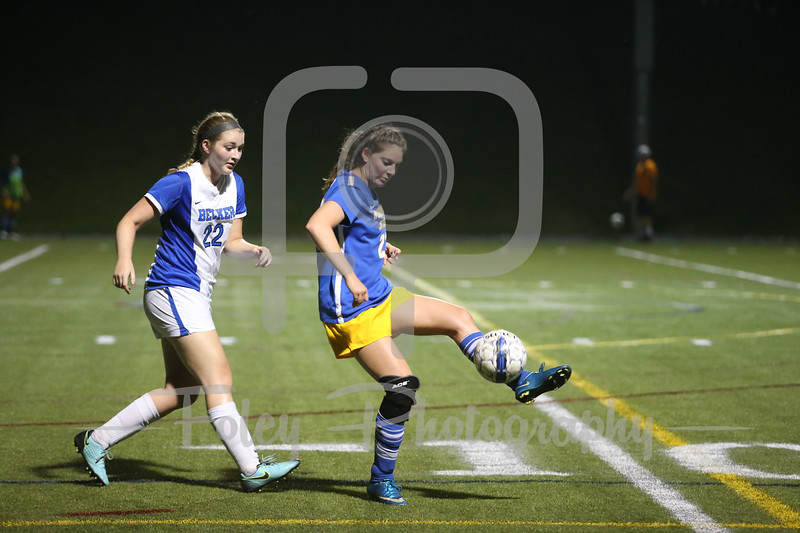 Worcester State Lancers Nikki DiPilla (22) Becker College Hawks defender Julia Campellone (22)