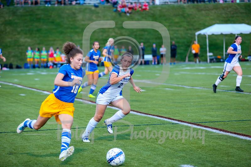 Worcester State Lancers Tsara LeBlanc (10) Becker College Hawks midfielder Autumn Audet (2)