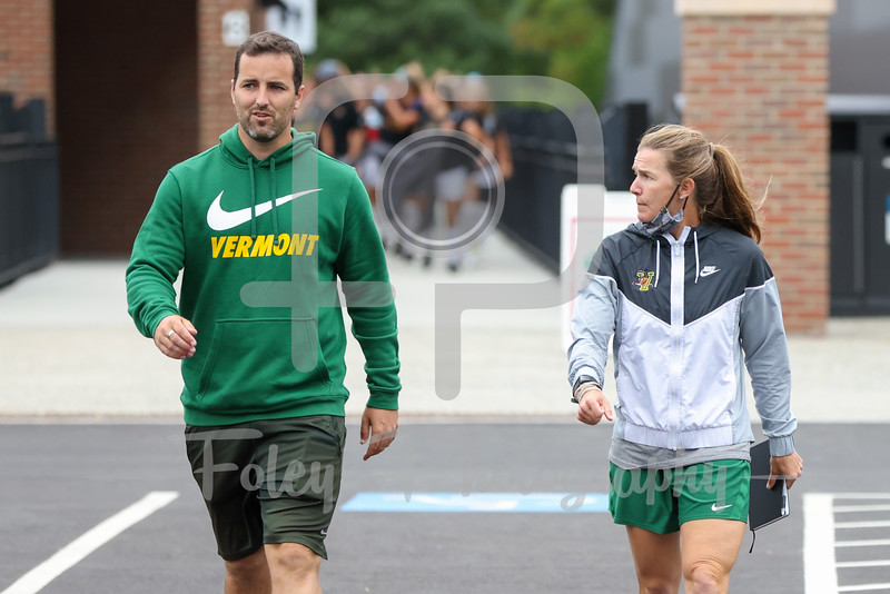 Aug. 29, 2021; Hanover, New Hampshire, USA; Vermont Catamounts head coach Kristi Huizenga Vermont Catamounts Assistant Coach Michael Skelton  walk out to the field before a non conference matchup between Vermont and Dartmouth. The Big Green won the game 2-1 over the Gaels at Burnham Field. Photo by Foley-Photography.