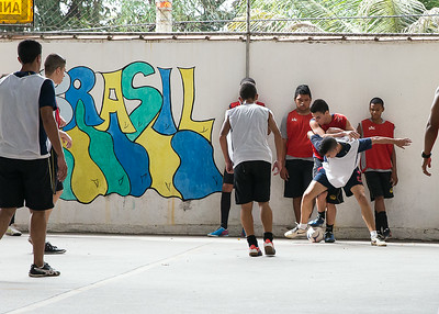 A local private school in Santa Cruz, Brazil, Centro de Integracao Objectivo holds futsol games at their school.  Players of all ages play with school members surrounding the covered field to watch and cheer.