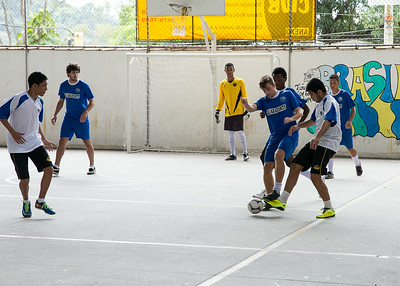 A local private school in Santa Cruz, Brazil, Centro de Integracao Objectivo holds futsol games at their school.  Players of all ages play with school members surrounding the covered field to watch and cheer.  In this game, two Americans joined the team in blue for their game.