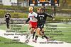 VB's Ryan Turner (21) challenges Mansfield Christian's Camden Craner (1) for possession of the ball.