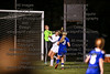 Findlay's goalkeeper, Marissa Wintrow (0) saves the ball catching it in the air off a St. Ursula free kick just as the Arrow's Morgan Swerlein (15) runs into her knocking her to the turf.