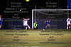 Findlay's goalkeeper, Marissa Wintrow (0) saves the ball just before St. Ursula's Grace Mancy (18) collides with her right in front of the net, off a free kick.