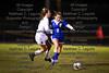 St. Ursula's Payton Sullivan (4) runs into Findlay's Jenna Marie Hohman (2) as she dribbles the ball upfield.