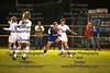 Findlay's Morgan Kirk (1) kicks the ball away from St. Ursula's Grace Mancy (18).