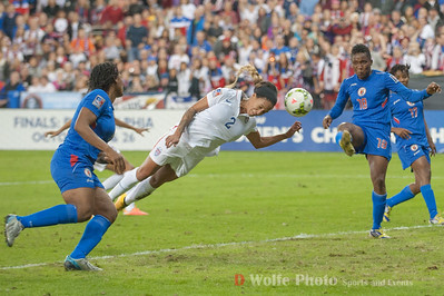 Sydney Leroux (2) puts her head in the path of a Haiti pass as Haiti defends their goal.
