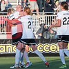 Spirit players Megan Oyster and Tori Huster are the first to swarm Joanna Lohman after her header went into the back left corner of the net for the first and only goal of the match between the Washington Spirit and Houston Dash.
