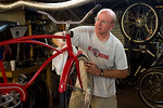 Harry Johnson refurbishing bicycles at the The ReCyclery.  Photo by Weldon Weaver.