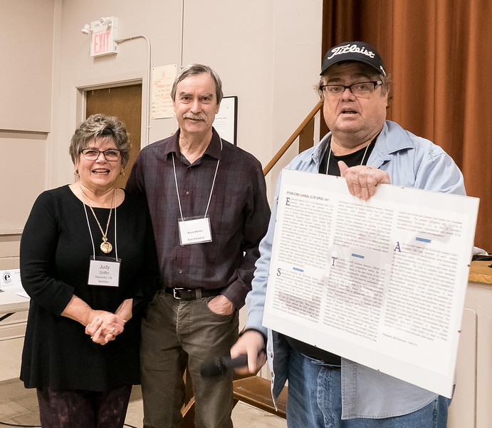 Past Presidents Judy Griffin, Bruce  Barton and Bruce Lewis, who prepared the early club minutes plaque.