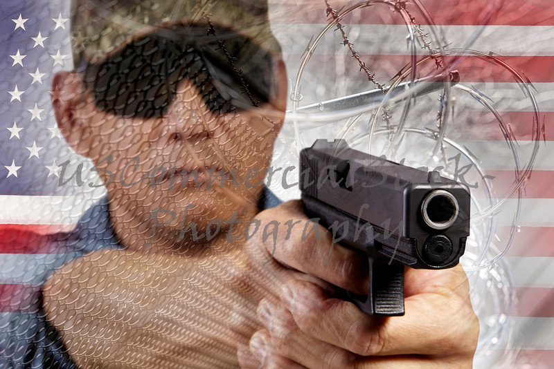 Lawman with gun and razor fence USA flag border barrier