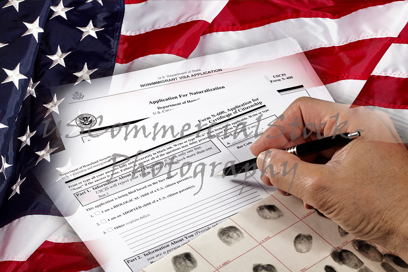 Man with American citizenship application on USA flag