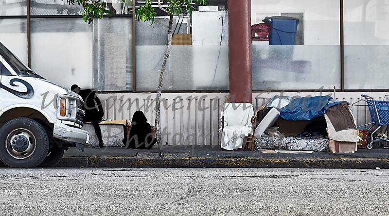 Homeless shadow figures inner city sidewalks