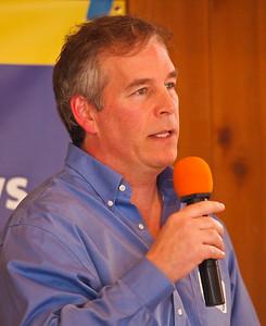 Emcee Peter Drekmeier, former Mayor of Palo Alto.