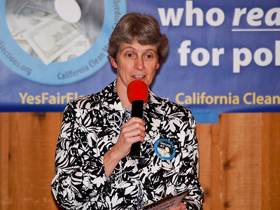 Nancy Neff, chair of the Action Council at the UU Church of Palo Alto, welcomes the participants.