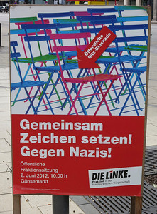 Sign for a public sit-in against Nazis.
