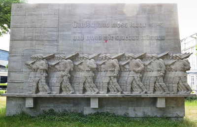 """Germany must live _______ (word removed from monument) and if we must die'  ..on a monument honoring Hamburg's WWII military dead"