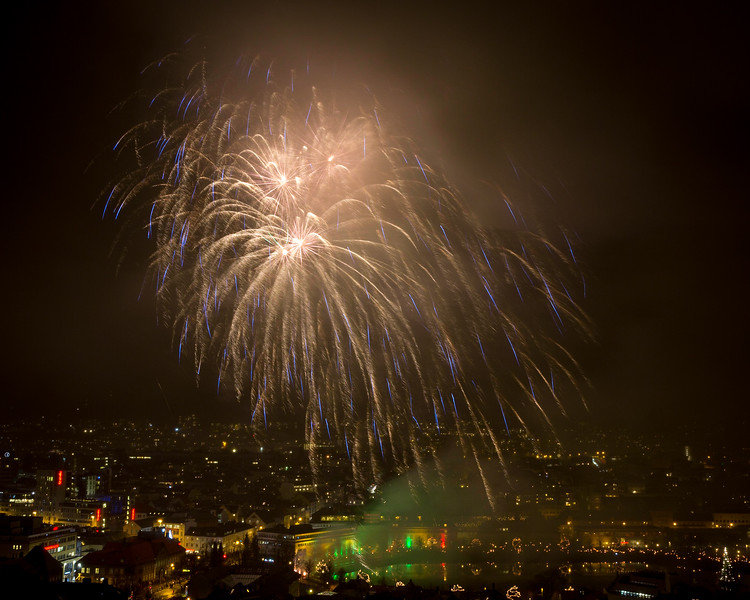 """This year's start to the Christmas period was once again celebrated in Bergen with the """"Festival of Light"""" ending in a magnificant firework display.<br /> On a wet and windy afternoon the smoke hung i the rain filled skies."""