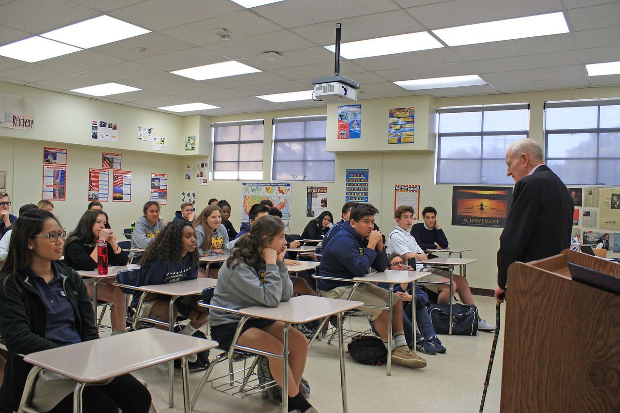 "Ken Olsen speaks to Notre Dame teacher Kathleen ""KC"" Reichert's U.S. history class."