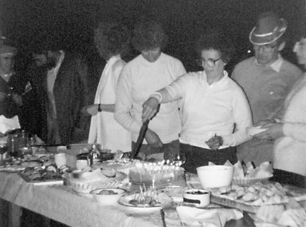 <font size=3><u> Sands Way Party </u></font> (BS0156)  This celebrates the 21st anniversary of the building of Sands Way. Edith Brooker(nee Beal) is cutting the cake.