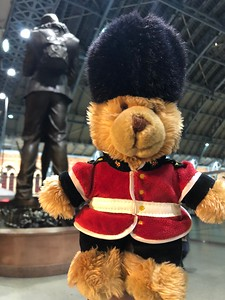 Teddy by The Meeting Place statue in St Pancras International