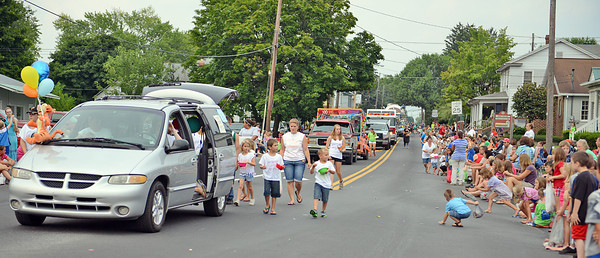 "Amanda August/For The Daily Item Spectators line Main Street to watch the Middleburg Fireman's Carnival parade on Thursday night. Middleburg's Reliance Hose #1's Fire Cheif Dwayne ""Butch"" Hackenburg said ""it's always full""; it was crowded the whole length of the parade route."