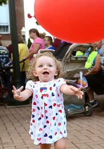 Lyra Knouse, 21 months, chases her balloon during National Night out in Sunbury Tuesday night August 7, 2012.