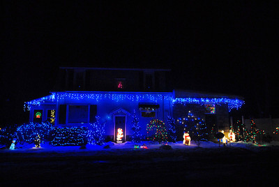 A house is decorated in blue lights on Van Horn Street in Sunbury on Wednesday night.