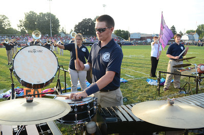 Shikellamy High School band member Kurtis Monahan, 16, bangs away during the pre-game show for Friday night's football game against Mount Carmel.