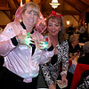 The Tewksbury Lions Club and Rotary Club joined forces on Friday night at the Tewksbury Country Club to host a Sock Hop-themed fundraising event to raise money for local charities. Collecting money so the guests could take their chance at winning raffle prizes are Lions Club member Dawn Callahan and President of the club Sherry Hubbard. SUN/JOHN LOVE