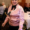 The Tewksbury Lions Club and Rotary Club joined forces on Friday night at the Tewksbury Country Club to host a Sock Hop-themed fundraising event to raise money for local charities. Dressed as a Pink Lady from Grease is Debbie Deputat. SUN/JOHN LOVE