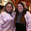 The Tewksbury Lions Club and Rotary Club joined forces on Friday night at the Tewksbury Country Club to host a Sock Hop-themed fundraising event to raise money for local charities. Dressed like the Pink Ladies from Grease is Maria O'Toole and Jill McLaughlin. SUN/JOHN LOVE