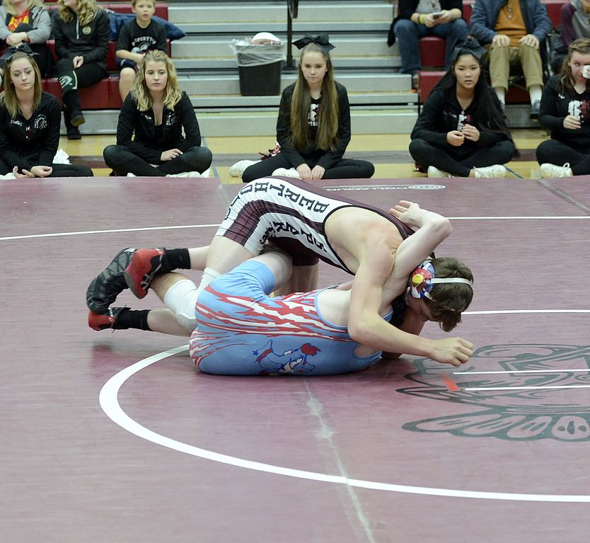 Berthoud's Kyle Conlon rolls Braden Baumgardner of Weld Central during their match on Saturday at the Soeby Classic in Berthoud. Conlon collected the fall in 2:52.