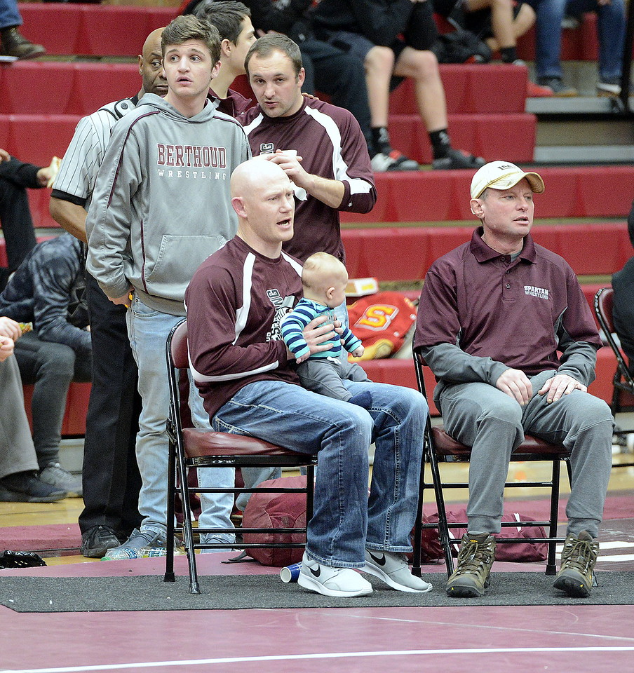 Berthoud coach Will Carron holds his son, Waylon, as he cheers on one of his wrestlers during the Soeby Classic Tournament on Saturday at BHS.