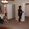 This photo is of two bedrooms.  The master, and an additional room.  Sofie (nice shoes!) is walking from master to the added room.  There is a sliding door connecting the two.  I think the builder thought the smaller room might be used as a study or as an added room.  That's the master bath behind Edith and her chauffer.