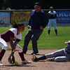 Chico State shortstop Cailin Garmon, left, cannot make the tag as UC San Diego's Danielle Stedman (17) steals second base as the Chico State softball team plays Friday, April 15, 2017, against UC San Diego in Chico, California. (Dan Reidel -- Enterprise-Record)