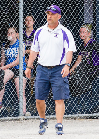 Record-Eagle/Brett A. Sommers Frankfort coach Mike Thompson stands on the third-base line during Tuesday's Division 4 quarterfinal against Coleman at Lincoln Elementary in Cadillac. Coleman won 1-0.